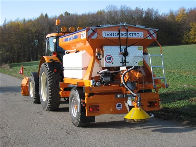 Tractor spreaders towed